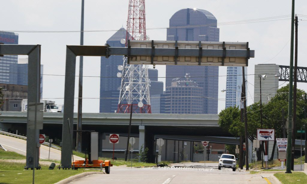The Dallas skyline emerges over Interstate 30 at Second Avenue in Fair Park on Thursday. A state transportation department study about downtown Dallas' aging highways includes three different options for I-30. They call for lowering the highway east of downtown or relocating to south of Fair Park. Mayor Mike Rawlings wants the City Council to choose an option by the end of the year.