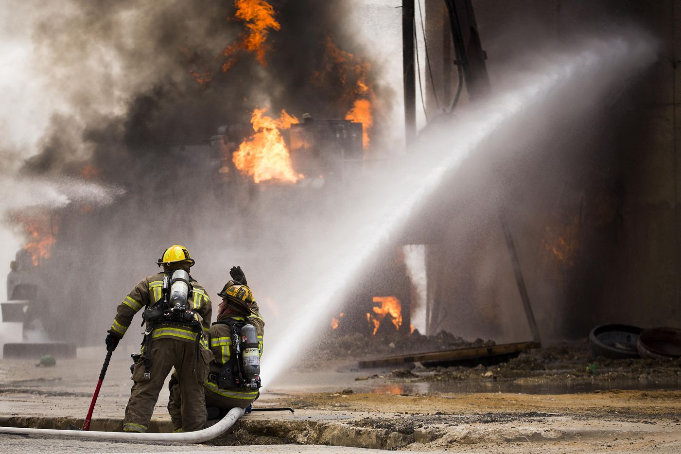 Dallas Fire-Rescue responds to the scene of a fire in the 2100 block of Main Street where an unspecified company struck a gas line on Friday, March 10, 2017, in Dallas.