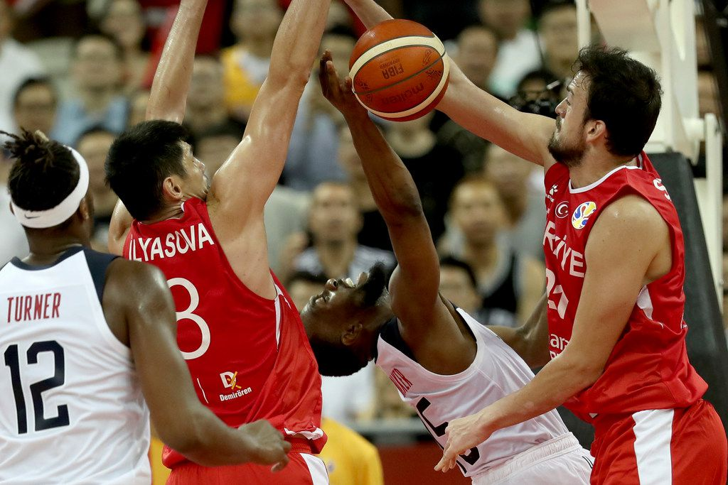 United States' Kemba Walker is blocked by Turkey's Ersan Ilyasova, second from left and Turkey's Sertac Sanli at right during a Group E match for the FIBA Basketball World Cup at the Shanghai Oriental Sports Center in Shanghai on Tuesday, Sept. 3, 2019. The United States beat Turkey 93:92.