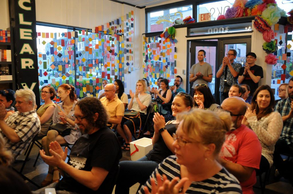 The crowd cheers on a fellow poet at White Rock Zine Machine launch party at Deep Vellum Publishing in Dallas, TX on July 22, 2016. (Alexandra Olivia/ Special Contributor)