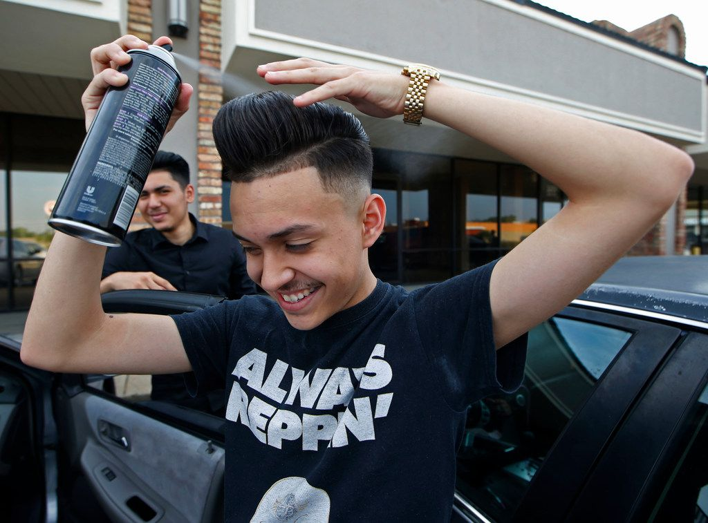 Gustavo Antunez perfects his pompadour hairstyle with hairspray before dancing at a quinceañera.