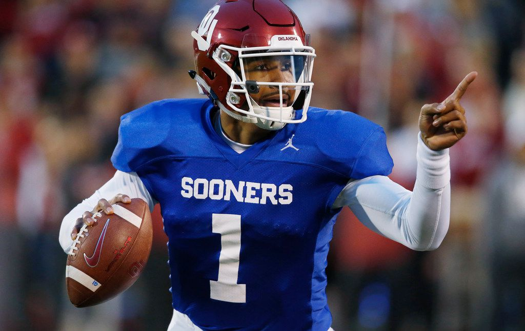 Oklahoma quarterback Jalen Hurts gestures during the NCAA college football team's spring game in Norman, Okla., Friday, April 12, 2019. (AP Photo/Sue Ogrocki) ORG XMIT: OKSO103