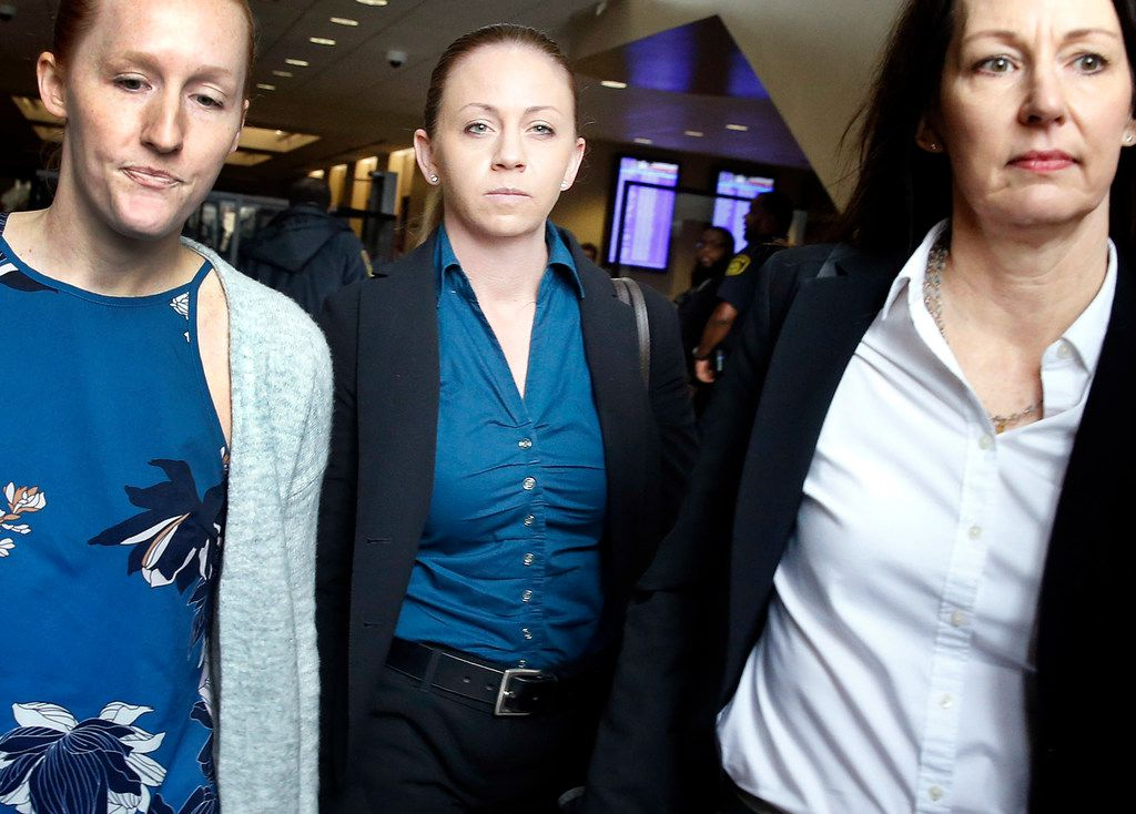Former Dallas police Officer Amber Guyger (center) leaves the Frank Crowley Courts Building in downtown Dallas.