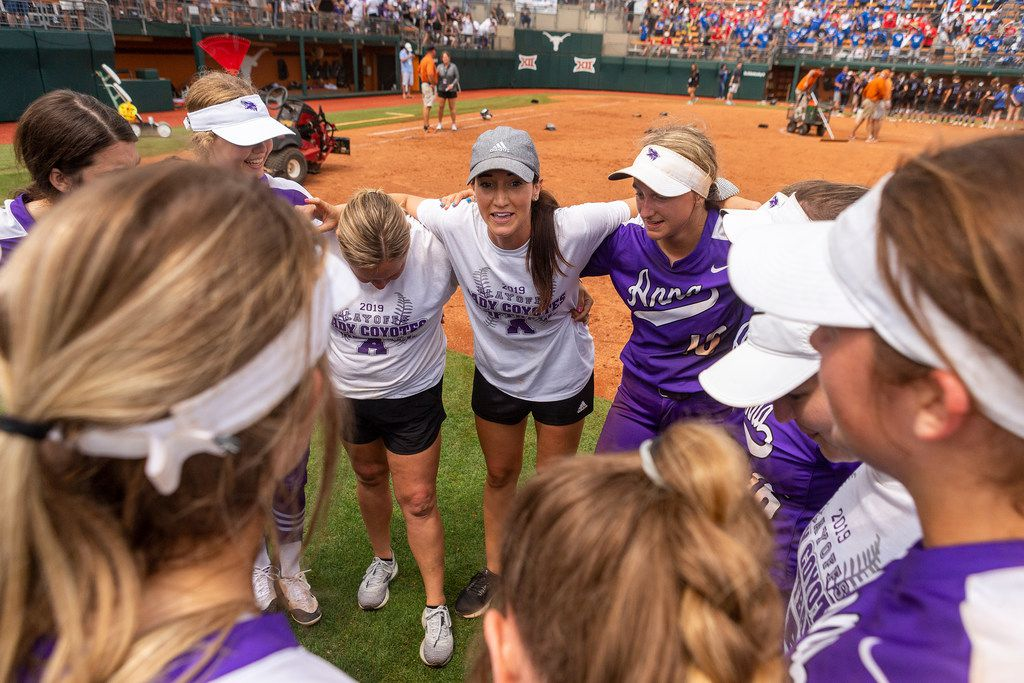 Anna head coach Lindsey Gage speaks with her team after a 6-4 win over Decatur during the UIL Class 4A state softball semifinal in Austin, Thursday, May 30, 2019. (Stephen Spillman/Special Contributor)