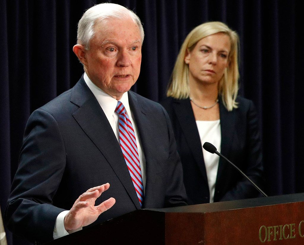 FILE - In this Tuesday, Dec. 12, 2017, file photo, U.S. Attorney General Jeff Sessions, left, speaks alongside Secretary of Homeland Security Kirstjen Nielsen during a news conference in Baltimore.