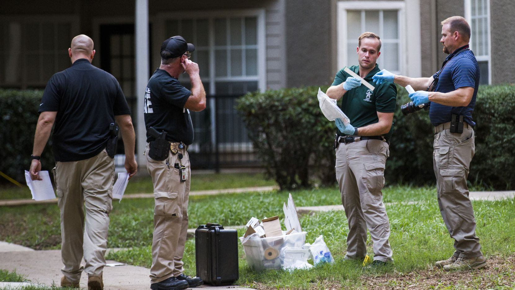 Lewisville police officers investigate a scene where a man fatally stabbed a 16-month-old  on Sunday.
