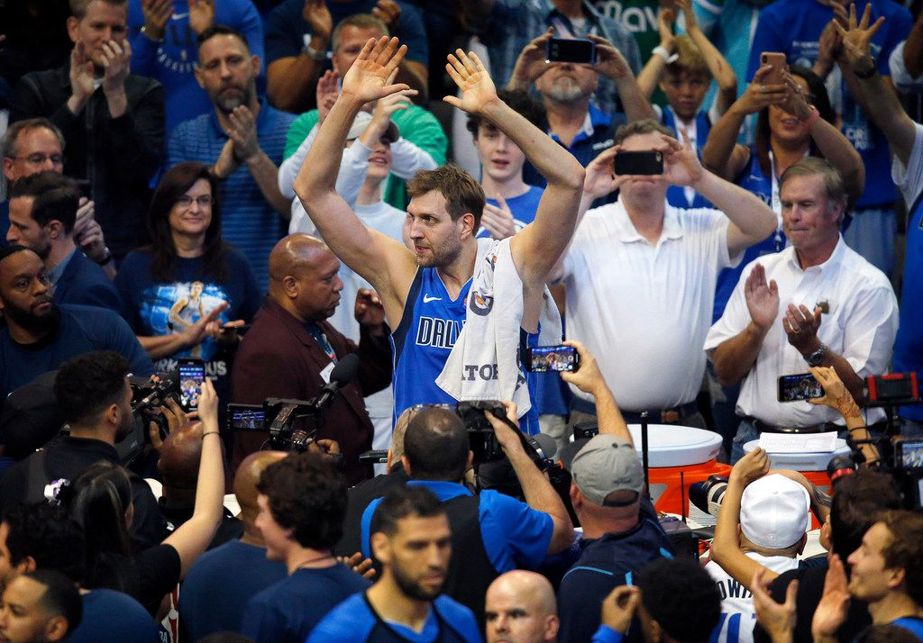 Dallas Mavericks forward Dirk Nowitzki (41) acknowledges the crowd's cheers after playing the Phoenix Suns at the American Airlines Center in Dallas, on Tuesday, April 9, 2019. Nowitzki is playing in his last home game of his 21st season with the team. (Tom Fox/Dallas Morning News/TNS)