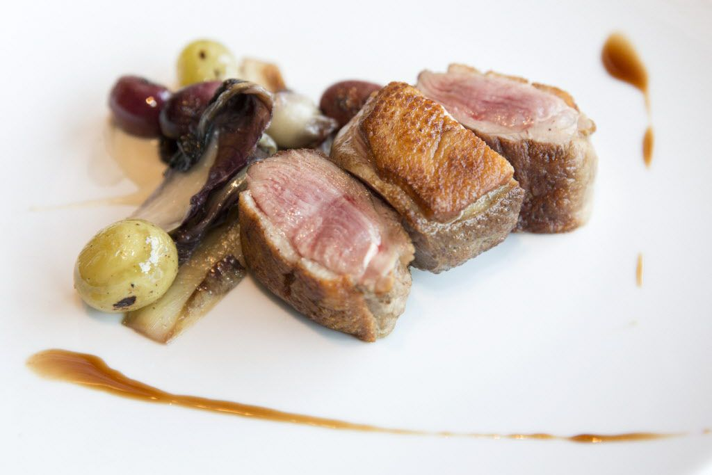 Under new chef-partner John Tesar, the Dallas Design District restaurant Oak has flashes of finesse.  Pekin duck breast with smoked sunchoke puree, roasted grapes, sauteed treviso and a drizzle of duck demiglass was terrific.