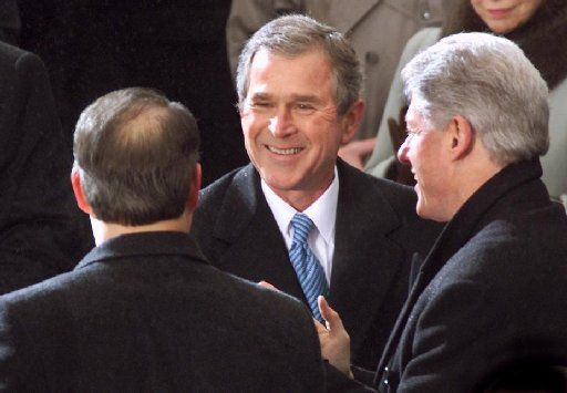 After taking the oath of office, President George W. Bush shook hands with Bill Clinton and Al Gore.