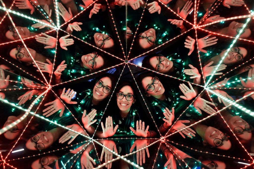 Raisa Ramos is seen inside of a kaleidoscope during the Winter Solstice Sunrise Celebration at the Perot Museum in Dallas, Friday morning, Dec. 21. The first time event celebrated the shortest day of the year with yoga, dancing and plenty of fun activities with science. Ben Torres/Special Contributor