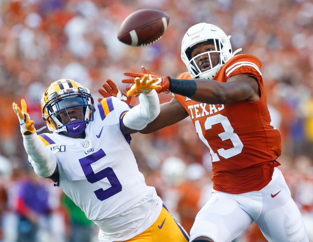 LSU cornerback Kary Vincent Jr. (5) breaks up a pass intended for Texas wide receiver Brennan Eagles (13) during the first quarter of a game on Saturday, Sept. 7, 2019, at Darrell K Royal-Texas Memorial Stadium in Austin.
