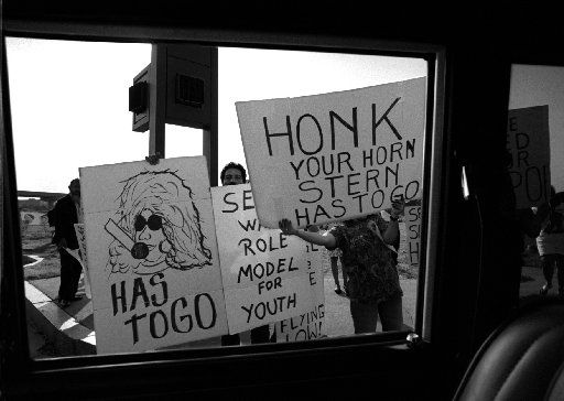 Protesters stand at the corner of O'Connor and Las Colinas boulevards near the offices of radio station  KEGL on April 2, 1995, to demonstrate against syndicated radio personality Howard  Stern, whose show is aired on the Dallas station. People were attempting to get Stern off the air in Dallas  following derogatory remarks he made about the death of Latino  pop recording star Selena. Nearly 50 protesters demonstrated at the corner and canvassed motorists to sign a petition to have  Stern removed from the air.