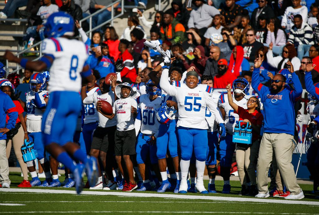 The Duncanville sideline gets pumped up during the first half of a Class 6A Division I Region I high school football matchup between Southlake Carroll and Duncanville on Saturday, Dec. 7, 2019 at McKinney ISD Stadium in McKinney, Texas. (Ryan Michalesko/The Dallas Morning News)
