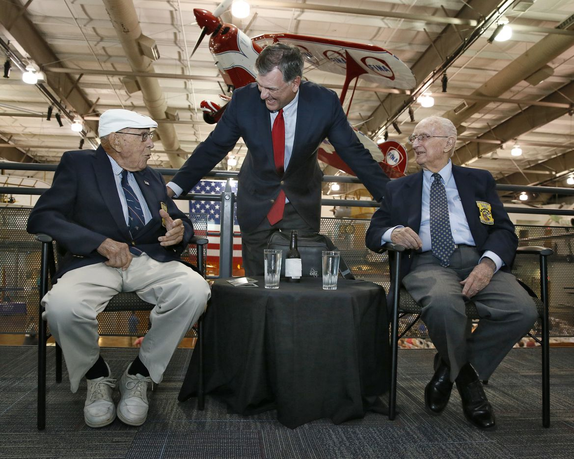 Dallas Mayor Mike Rawlings (center) talks to Col. Carrol V. Glines, (right) author and official historian of the Doolittle Raiders and Richard Cole, (left) co-pilot for Jimmy Doolittle , in a reception to celebrate Cole's 100th birthday and to honor the mission at Frontiers of Flight Museum in Dallas in Dallas,  September 7, 2015. (Nathan Hunsinger/The Dallas Morning News) ORG XMIT: moonday_0719met