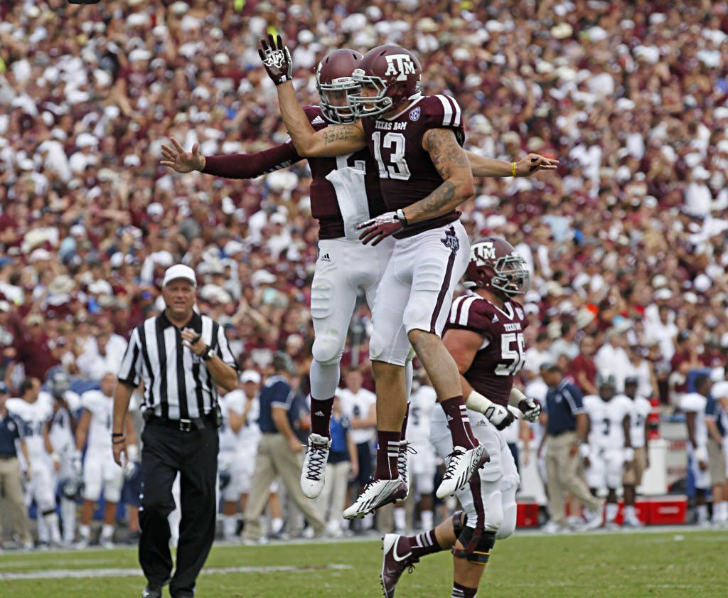 Texas A&M Aggies quarterback Johnny Manziel (2) and wide receiver Mike Evans (13)  celebrate a third quarter touchdown against the Rice Owls during their NCAA football game at Kyle Field in College Station , Texas, on August 31, 2013. (Michael Ainsworth/The Dallas Morning News)