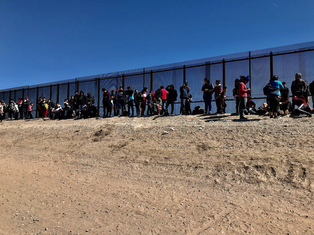 Migrants who crossed the border and turned themselves in to the border patrol were being held along the fence in an area known as El Paso's Lower Valley. More than 700 were detained between El Paso and the Lower Valley on the day this photo was taken, March 6, 2019. Some groups came in pairs, others by the dozens. The largest group was more than 400.