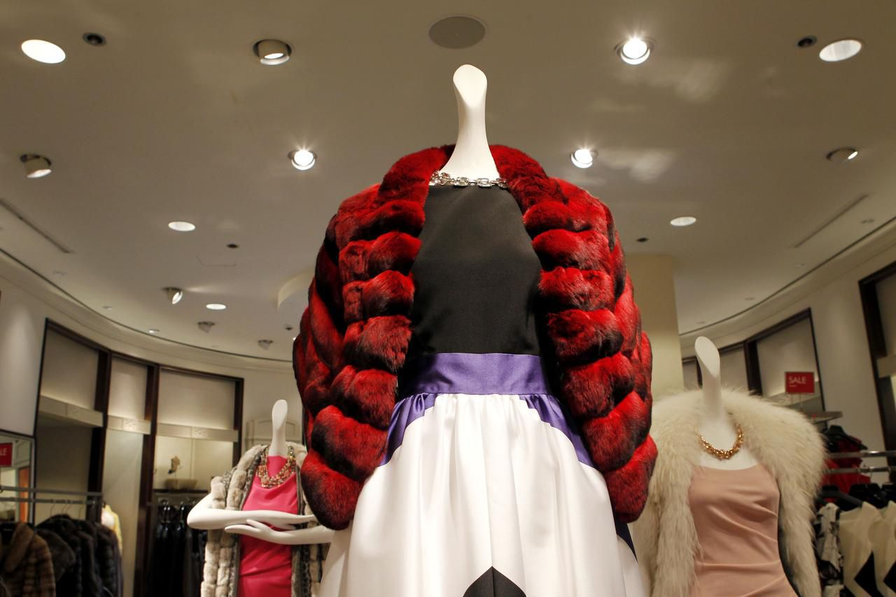 A $9,000 red-dyed chinchilla stole  awaited a buyer at Neiman Marcus' NorthPark Centerstore. The retailer, saddled with debt from two leveraged buyouts in the last decade, cut 500 jobs on Thursday.