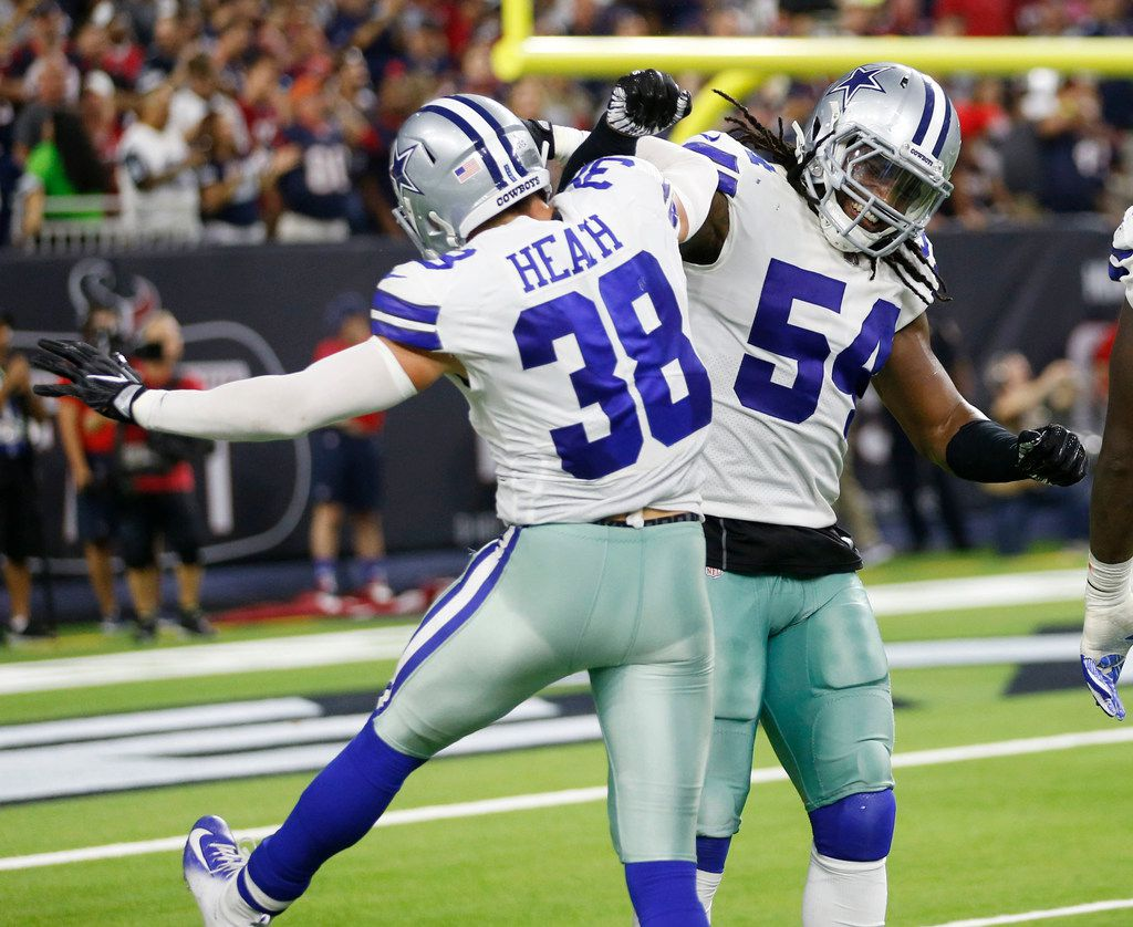 Dallas Cowboys linebacker Jaylon Smith (54) congratulates Dallas Cowboys strong safety Jeff Heath (38) after he forced an incomplete pass on a third down attempt in the red zone that led to a Houston Texans field goal late in the fourth quarter of play at NRG Stadium in Houston on Sunday, October 7, 2018. Houston Texans defeated Dallas Cowboys 19-16 in overtime. (Vernon Bryant/The Dallas Morning News)