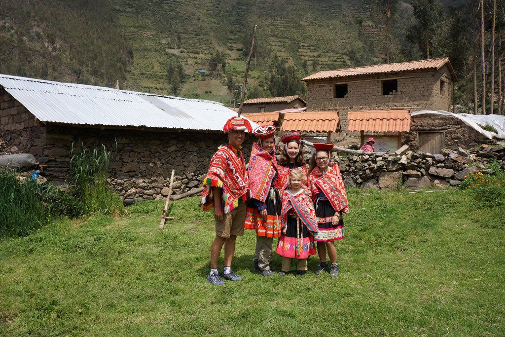 From left: Ken, Deborah, Katherine and Isabelle Adams, with Trinity in front, in traditional Peruvian garb during the family's eight-month tour of the world that included visits to countries where wells have been funded by Paper for Water.