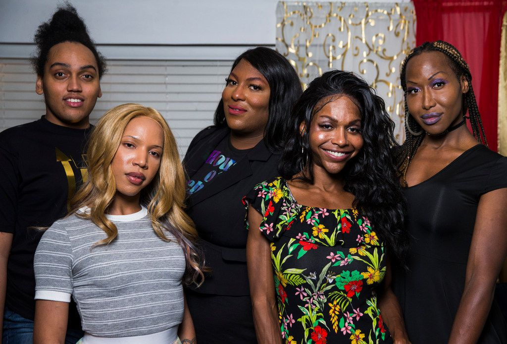 """From left, Marquel Dominique, Alana Bursey, Robyn """"Pocahontas"""" Crowe, Mieko Hicks, and LeShay Weeks pose for a photo on Friday, September 27, 2019 at Weeks' home in Dallas. The group hosts a weekly radio show called Trans-Fusion, where they talk about their experiences as black transgender women. (Ashley Landis/The Dallas Morning News)"""