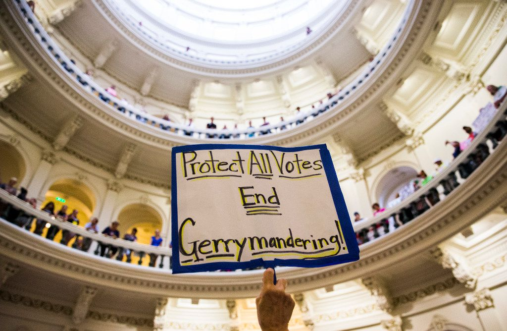 A protester holds up a sign inside the capitol rotunda during a One Texas Resistance Rally on the first day of a legislative special session on Tuesday, July 18, 2017 at the Texas state capitol in Austin, Texas. (Ashley Landis/The Dallas Morning News)