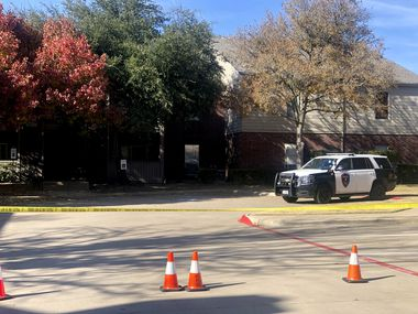 Police tape blocked off an apartment building in the 2300 block of Pebble Vale Drive, where Plano police found a man and woman in their 70s slain in their apartment on Sunday, Nov. 17, 2019.