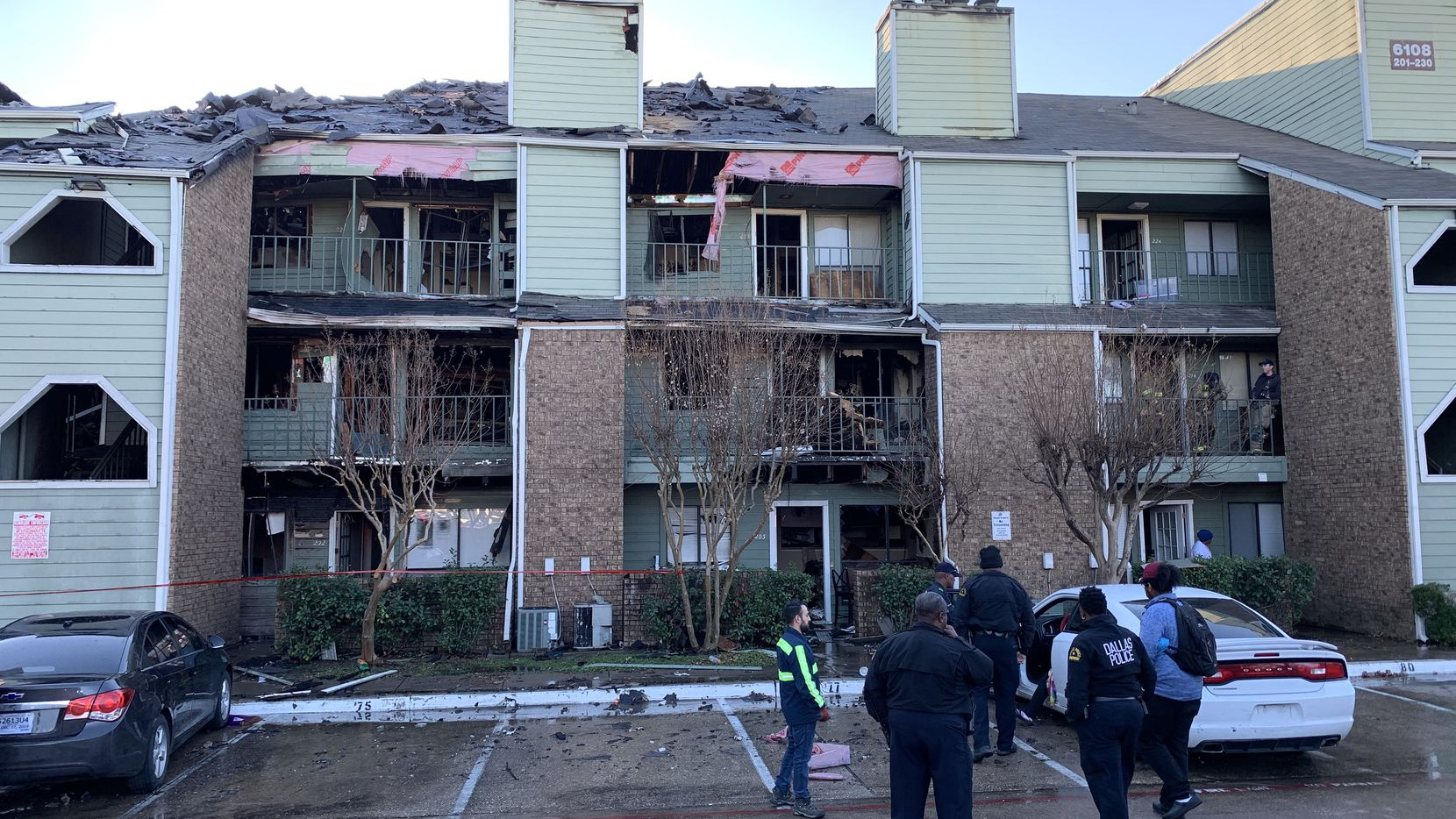 Dallas Fire-Rescue works the aftermath of a fire at the Sable Ridge Condominiums at 6108 Abrams Road on Wednesday morning, Dec. 4, 2019, in Dallas.