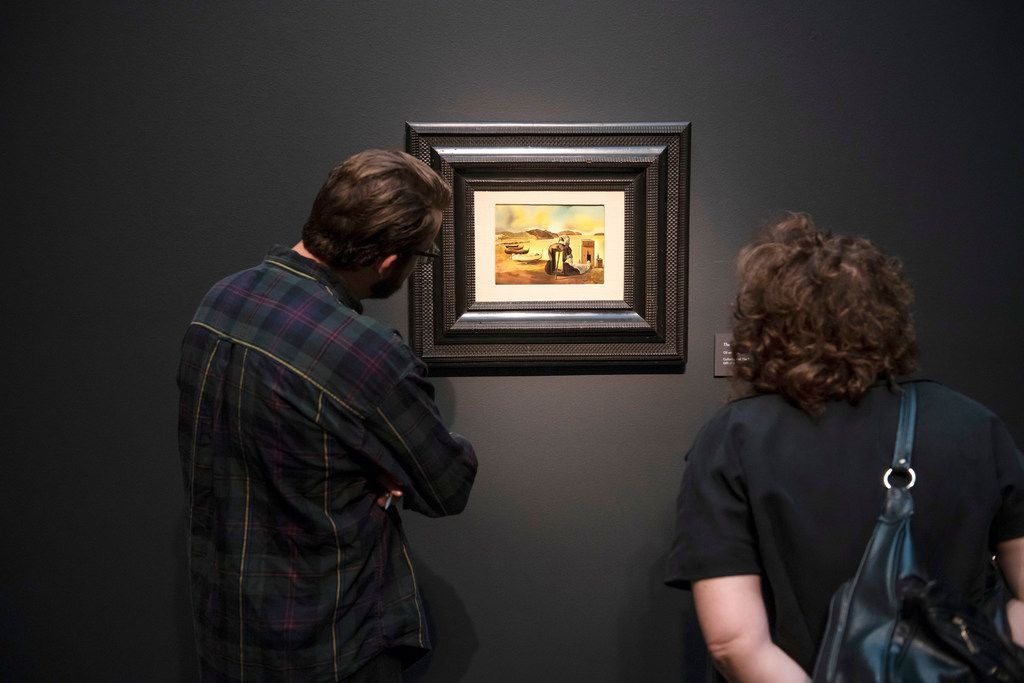 "Visitors at Southern Methodist University look at a Salvador Dali painting during an exhibit preview at the University's Meadows Museum in Dallas. The painting is part of an exhibit featuring the surrealist's lesser-known small scale paintings titled ""Dali: Poetics of the Small"""