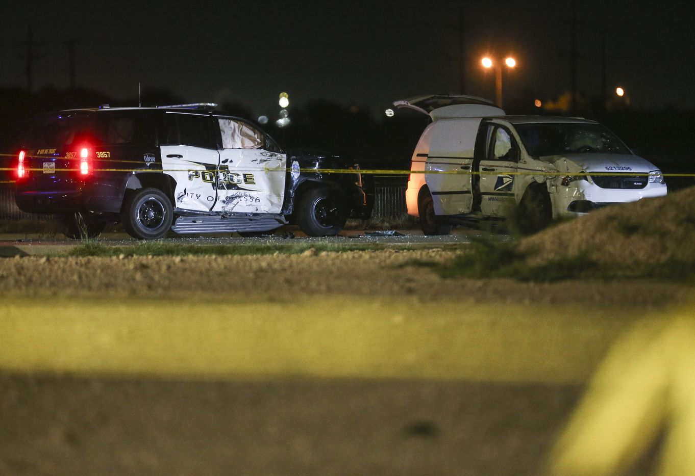 A crashed U.S. Postal Service vehicle and Odessa Police vehicle are seen late Saturday, Aug. 31, 2019 at a Cinergy movie theatre in Odessa, Texas.