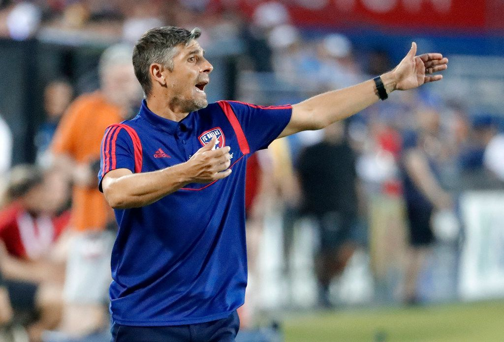 FC Dallas head coach Luchi Gonzalez instructs his team during a defensive transition in the first half of an MLS soccer match against the Vancouver Whitecaps in Frisco, Texas, Wednesday, June 26, 2019. (AP Photo/Tony Gutierrez)