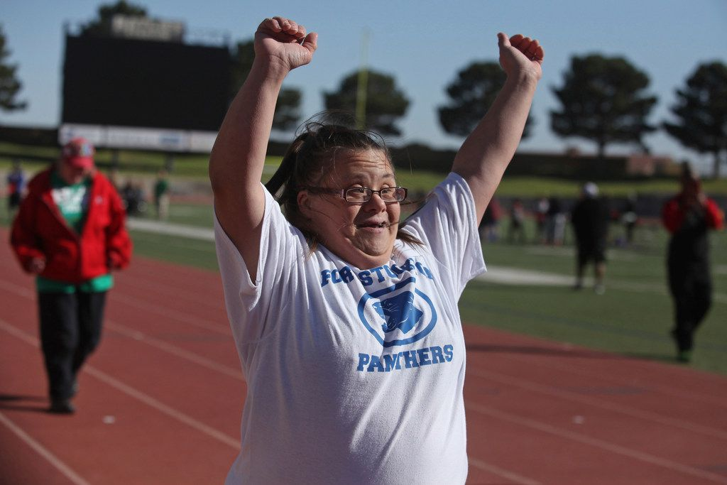 Nicole Mishnick throws her arms up in celebration after finishing first her heat of a 50-meter dash during the Special Olympics Texas' 2018 Spring Games in April 2018.(Jacob Ford/Odessa American via AP)