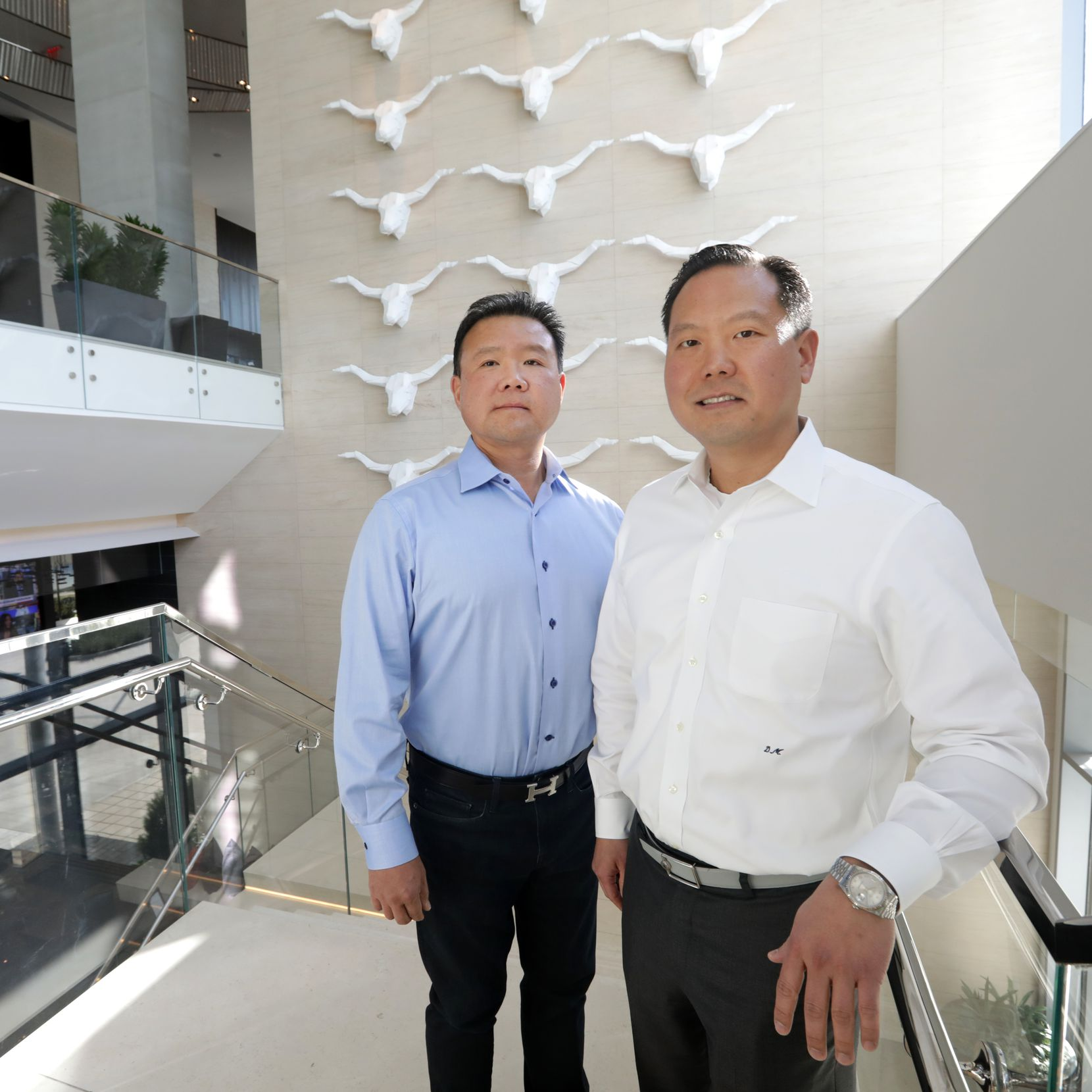 Sam Moon, left, and Daniel Moon are shown at the Renaissance Hotel in Plano.