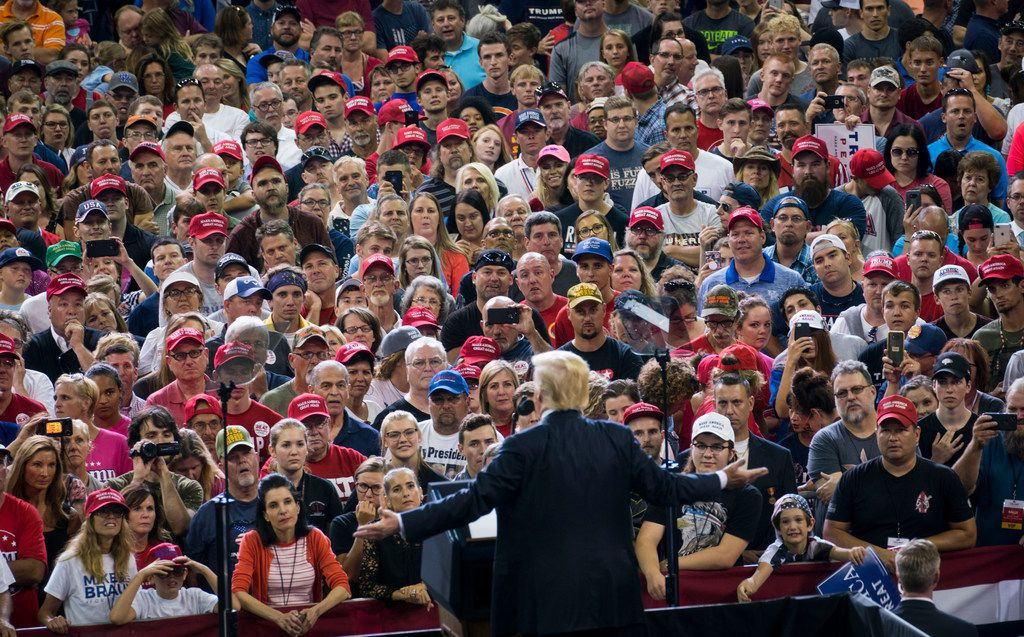 Attendees listen as President Donald Trump speaks at a campaign-style rally at the Ford Center in Evansville, Ind., Aug. 30, 2018.