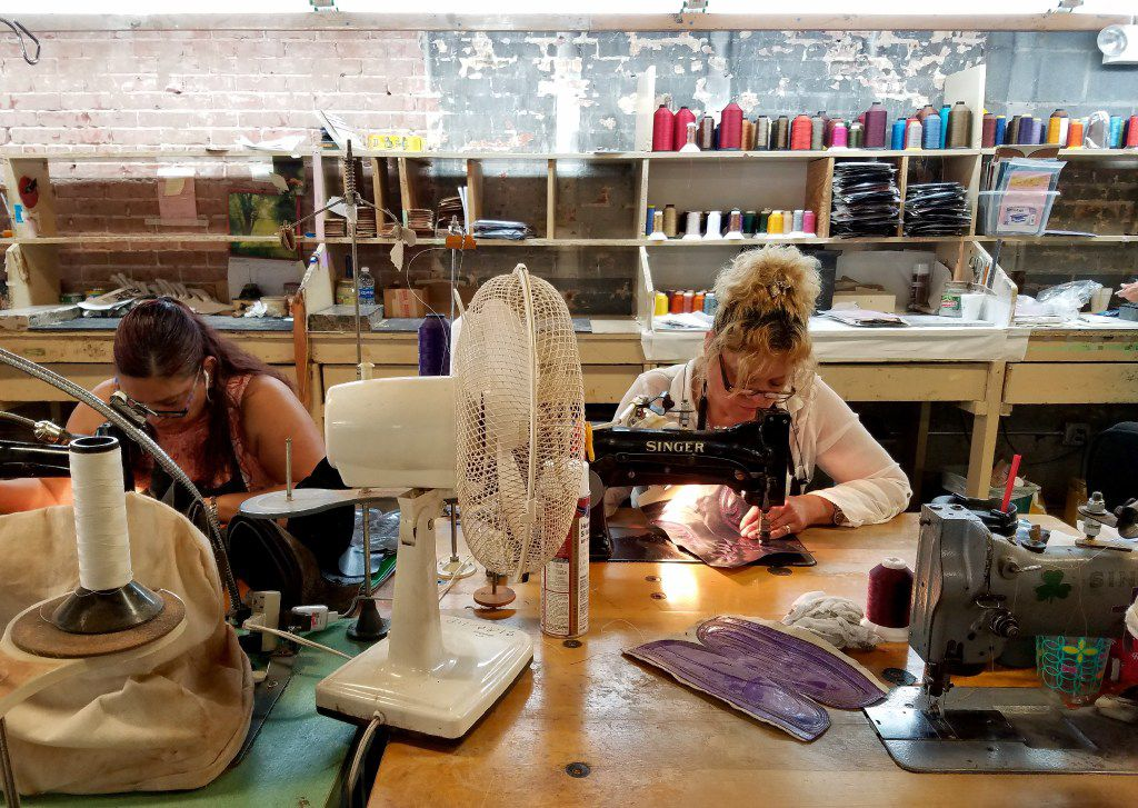 Using vintage Singer sewing machines, workers stitch patterns on boot leather at M.L. Leddy's in San Angelo.