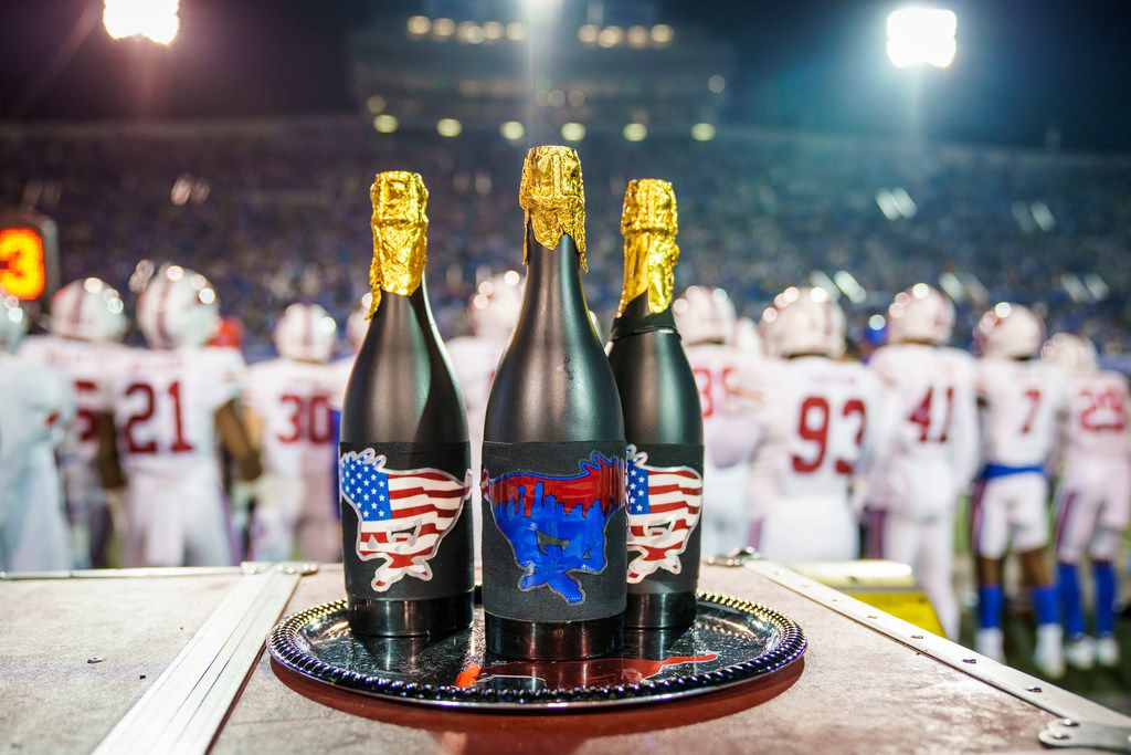 Champagne bottles on the SMU bench during the second half of an NCAA football game against Memphis at Liberty Bowl Memorial Stadium on Saturday, Nov. 2, 2019, in Memphis, Tenn. (Smiley N. Pool/The Dallas Morning News)