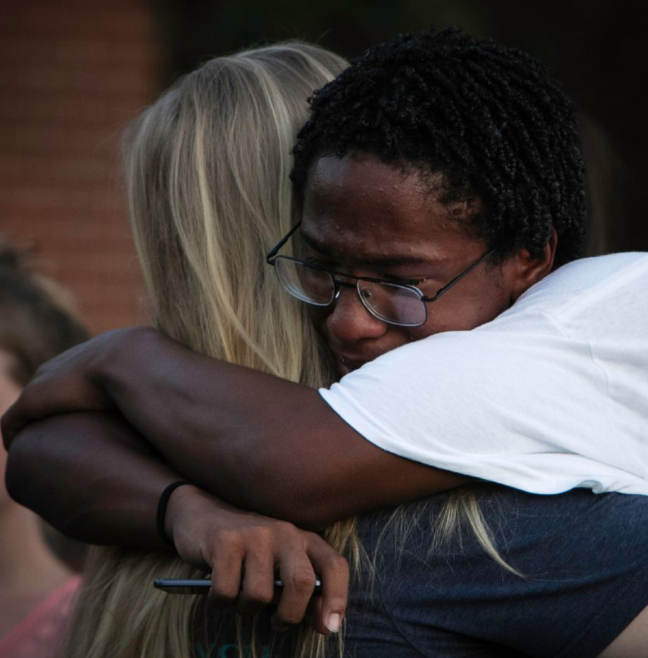 Lafayette Armstrong hugs his friends during a prayer vigil held in honor of Kaytlynn Cargill at Central Junior High School in Euless, Texas on June 22, 2017.