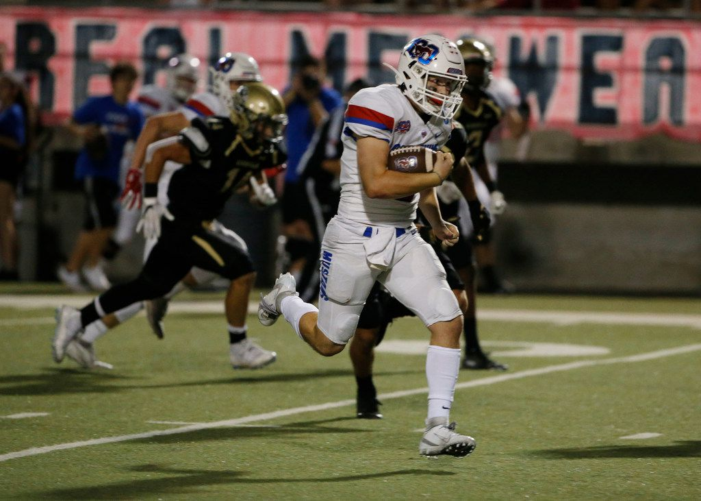 Grapevine quarterback Austin Alexander (9) keeps the ball and runs for yardage against Birdville during the first half of their high school football game in North Richland Hills, Texas on October 4, 2019. (Michael Ainsworth/Special Contributor)