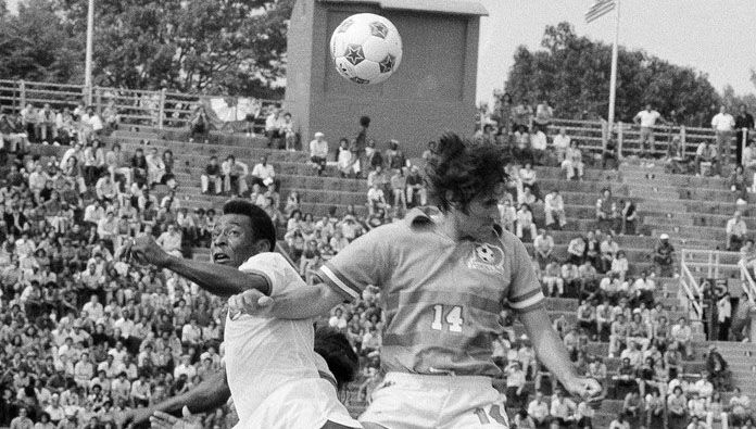 Dallas Tornado midfielder Bobby Moffat (14) goes up for a header against New York Cosmos star Pelé during a June 1975 exhibition game at Downing Stadium on Randall's Island in New York.