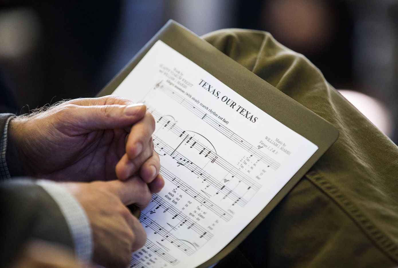 "A singer holds sheet music to ""Texas Our Texas"" during the first day of the 85th Texas Legislative Session on Tuesday at the Texas State Capitol in Austin."