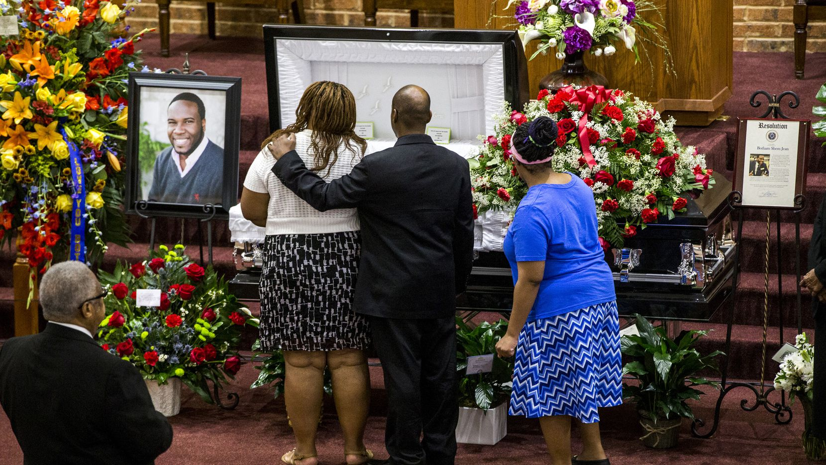 Mourners console each other during the public viewing before the funeral of Botham Shem Jean at the Greenville Avenue Church of Christ on Thursday, Sept. 13, 2018 in Richardson, Texas. He was shot and killed by a Dallas police officer in his apartment last week in Dallas. (Shaban Athuman/Dallas Morning News)