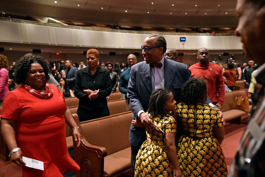 Dallas County Commissioner John Wiley Price, right, greets two young girls during church donations for a Sunday service at Friendship-West Church in South Dallas, Feb. 26, 2017. Ben Torres/Special Contributor