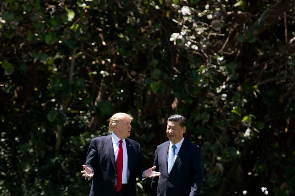 President Donald Trump and Chinese President Xi Jinping visit at Trump's Mar-a-Lago estate in West Palm Beach, Fla. The two leaders are expected to meet in November at the G-20 Summit and possibly the Asia-Pacific Economic Cooperating forum.