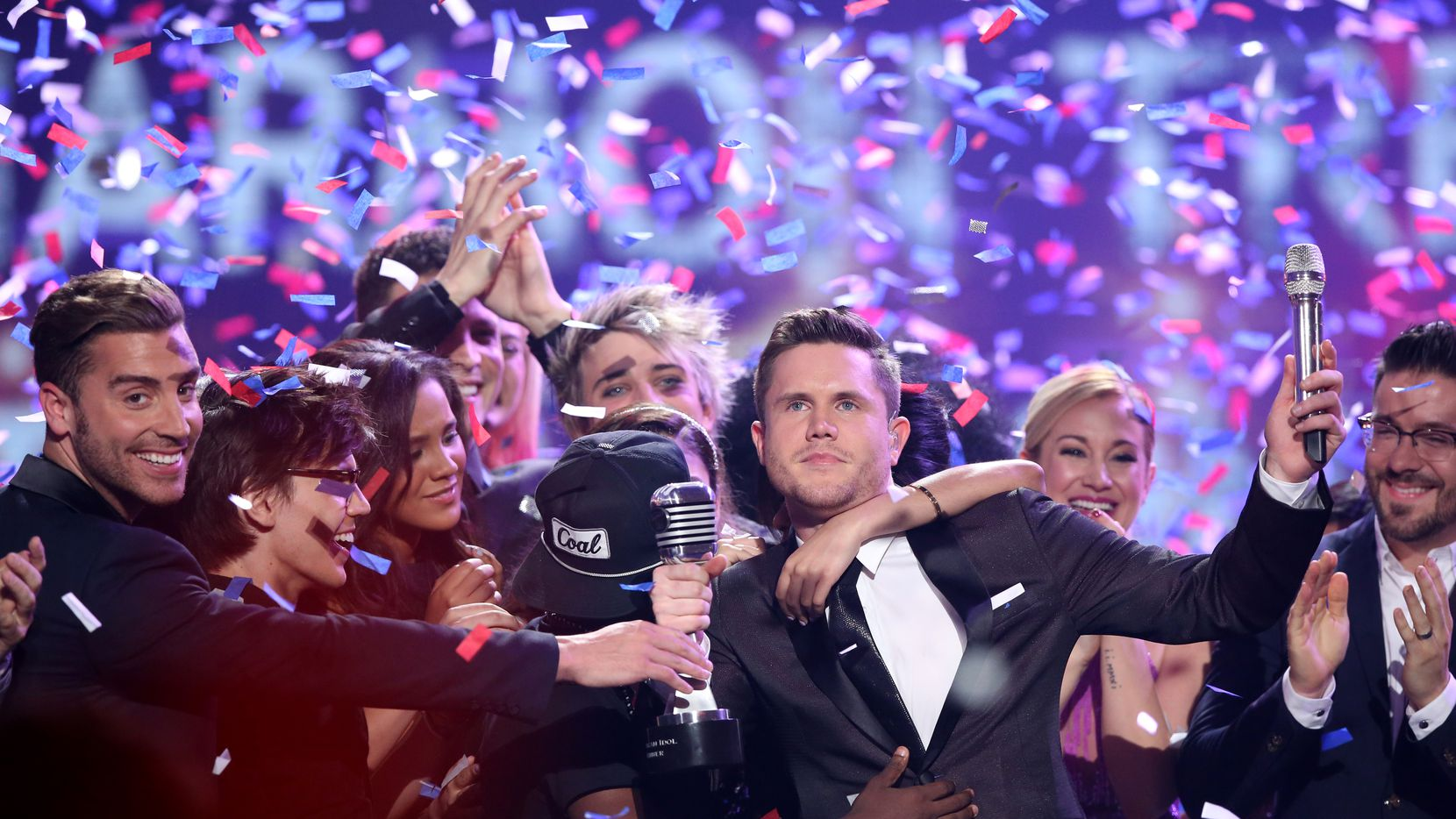 "Trent Harmon, center, winner of ""American Idol"" The Farewell Season celebrates with fellow contestants during the season finale at the Dolby Theatre on Thursday, April 7, 2016, in Los Angeles."