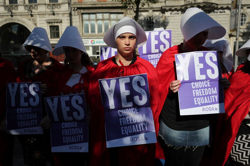 Volunteers from Reproductive rights, against Oppression, Sexism & Austerity (ROSA) dressed as characters from The Handmaid's Tale, demonstrate in Dublin on May 23, 2018, calling for a 'Yes' vote in Ireland's abortion referendum.