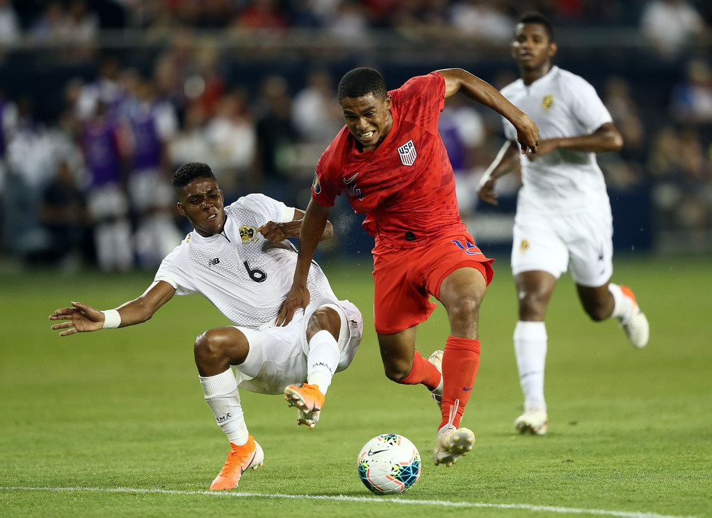 KANSAS CITY, KANSAS - JUNE 26:  Reggie Cannon #14 of the United States is fouled by Kevin Galvan #6 of Panama during the CONCACAF Gold Cup match at Children's Mercy Park on June 26, 2019 in Kansas City, Kansas. (Photo by Jamie Squire/Getty Images)