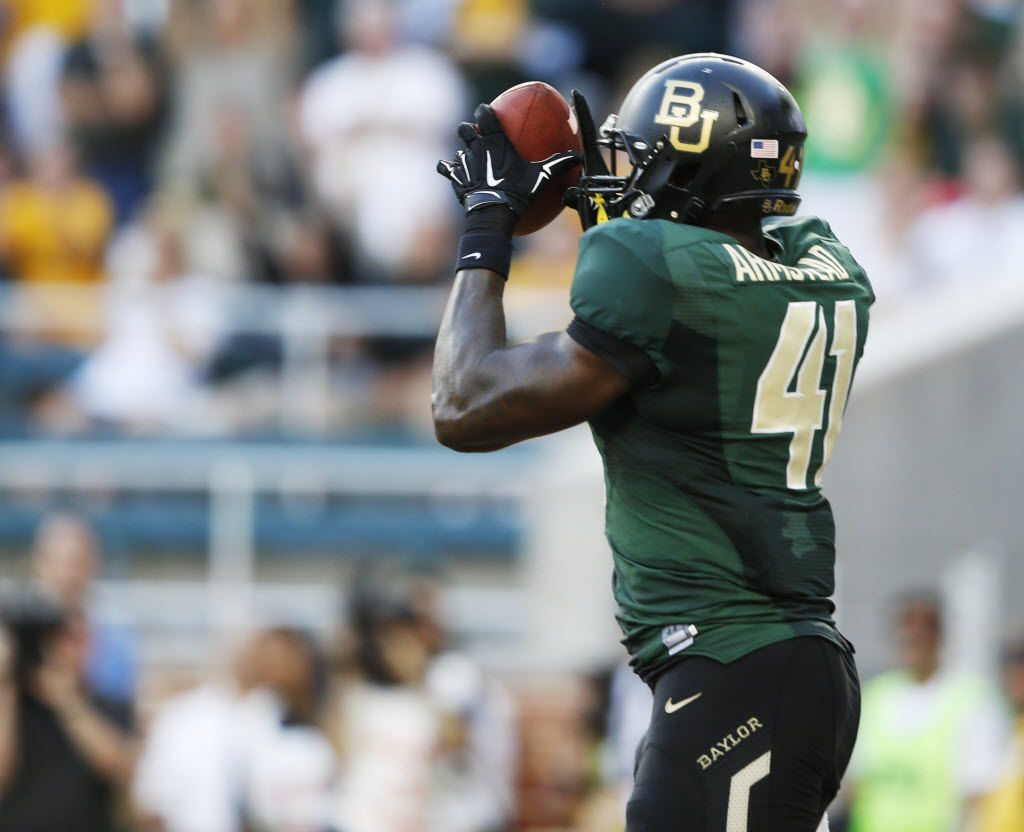Baylor tight end Tre'Von Armstead (41) catches a pass in the end zone for a touchdown during the first half of play against SMU in the inaugural game  at McLane Stadium in Waco on Aug. 31, 2014.