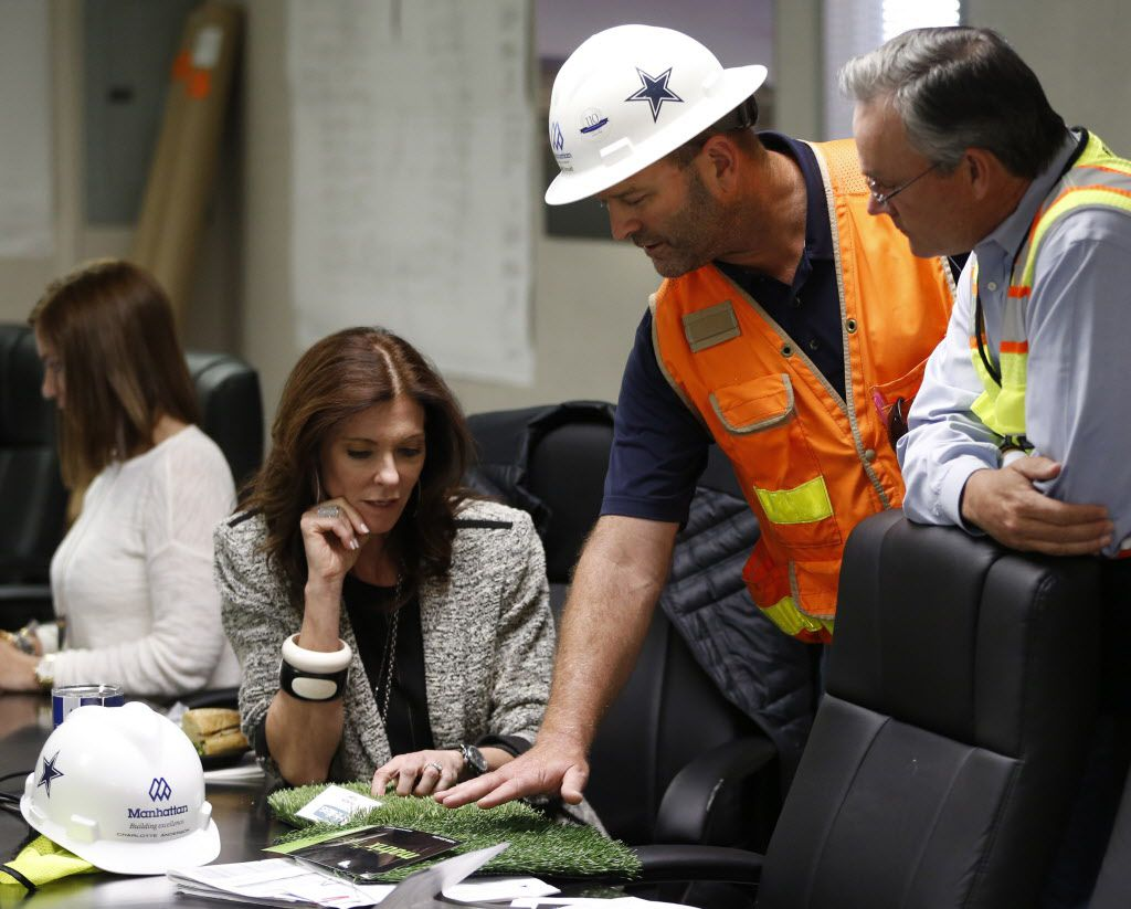 Stadium General Manager, Jeff Stroud (Center) of the Dallas Cowboys shows Charlotte Jones Anderson (left) Executive Vice President and Chief Brand Officer for the Dallas Cowboys and Project Manager Mark Hickman (right) of Legends two options for the artificial grass to use in the stadium at the Dallas Cowboys new headquarters at The Star in Frisco, on Tuesday, May 3, 2016. The Star a joint project with the City of Frisco is scheduled to open in August. (Vernon Bryant/The Dallas Morning News)