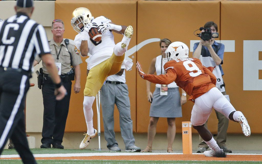 Notre Dame wide receiver Equanimeous St. Brown (6) catches a fort-quarter touchdown pass in front of Texas cornerback Davante Davis (9) during the Notre Dame Fighting Irish vs. the University of Texas Longhorns NCAA football game at Darrell K. Royal Memorial Stadium in Austin on Sunday, September 4, 2016. (Louis DeLuca/The Dallas Morning News)