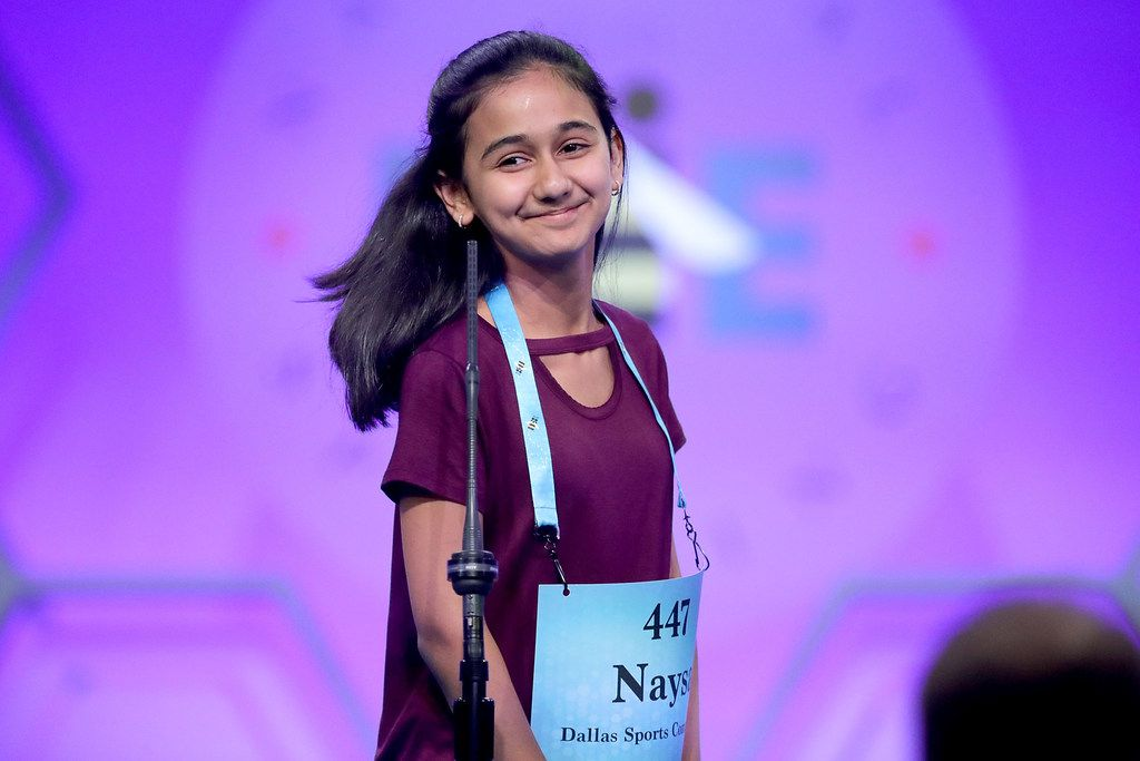 Naysa Modi, an eighth-grader from Reynolds Middle School in Prosper, is competing in her fifth Scripps National Spelling Bee. She smiles after correctly spelling the word 'telyn' during the final rounds of the 91st Scripps National Spelling Bee at the Gaylord National Resort and Convention Center May 31, 2018 in National Harbor, Maryland.