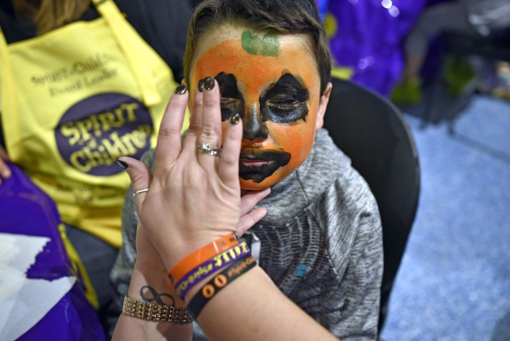Hunter McCall, 10, of Tulsa, has a jack-o'-lantern painted on his face during a special Halloween event hosted by Children's Health and Spirit of Halloween for pediatric patients at Children's Medical Center Dallas on Oct. 15, 2018. The event hosted free costumes, face painting and Halloween themed arts and crafts.